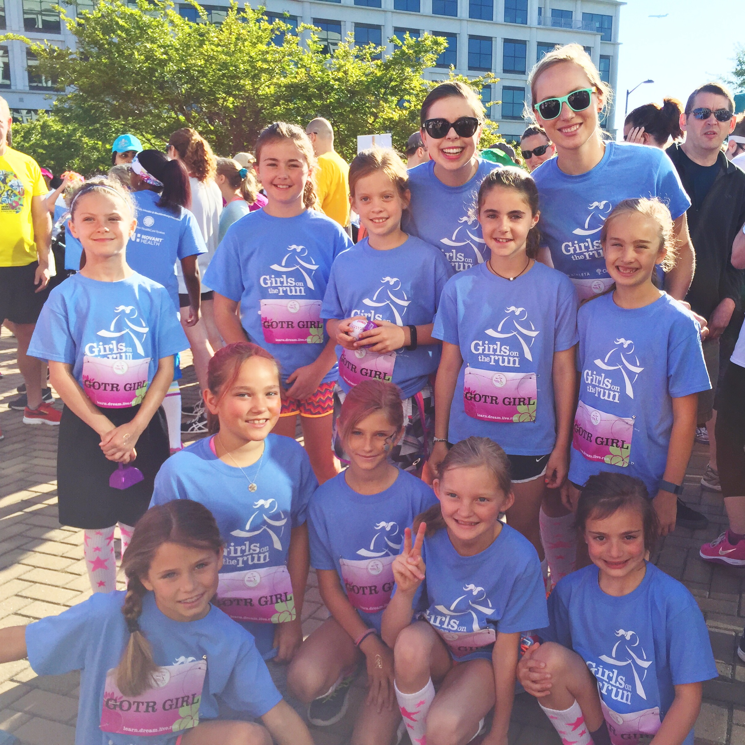 A Girls on the Run coach with her team at the 5K