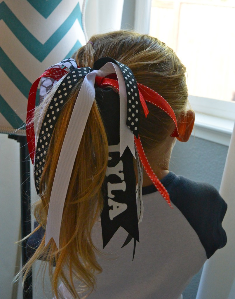 Girl wearing hair tie with ribbons