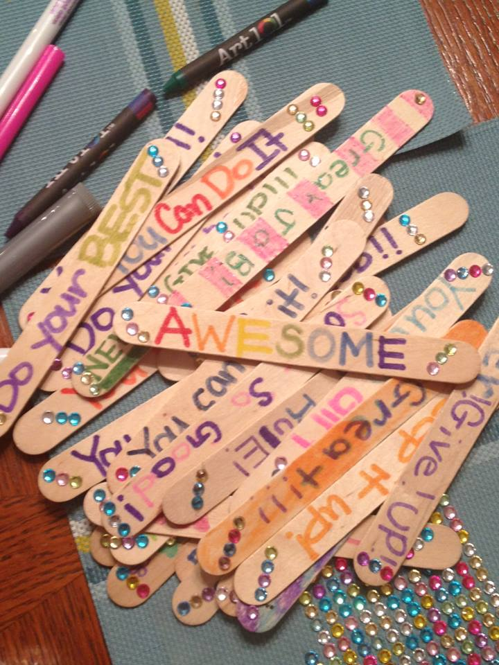 Popsicle sticks decorated for Girls on the Run lap counters